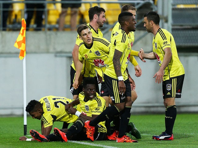 Roy Krishna (L) of the Phoenix celebrates with teammates after scoring a goal during the round three A-League match between the Wellington Phoenix and the Brisbane Roar at Westpac Stadium on October 24, 2015