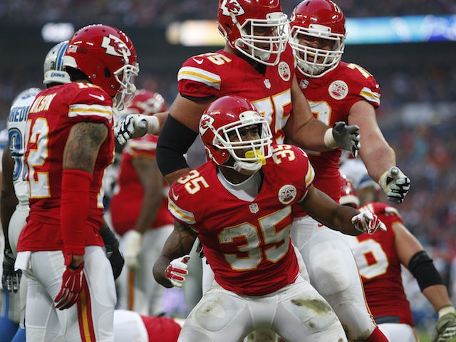 Charcandrick West #35 of Kansas City Chiefs celebrates scoring a touchdown during the NFL game between Kansas City Chiefs and Detroit Lions at Wembley Stadium on November 01, 2015 in London, England.
