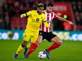 Jordan Amavi of Aston Villa is challenged by Graziano Pelle of Southampton during the Capital One Cup Fourth Round match between Southampton v Aston Villa at St Mary's Stadium on October 28, 2015 in Southampton, England.