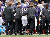 Wide receiver Steve Smith #89 of the Baltimore Ravens is helped off the field by medial staff after being injured in the third quarter against the San Diego Chargers at M&T Bank Stadium on November 1, 2015