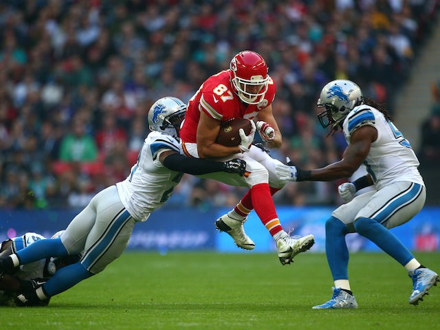 Travis Kelce #87 of the Kansas City Chiefs is tackled by Glover Quin #27 of the Detroit Lions defence during the NFL match between Kansas City Chiefs and Detroit Lions at Wembley Stadium on November 01, 2015 in London, England.