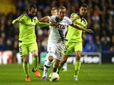 Harry Kane of Spurs is challenged by Steven Defour (L) of Anderlecht and Leander Dendoncker (R) of Anderlecht during the UEFA Europa League Group J match between Tottenham Hotspur FC and RSC Anderlecht at White Hart Lane on November 5, 2015 in London, Uni