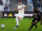 Nice's Ivorian midfielder Jean Michel Seri (R) vies with Marseille's Spanish defender Javier Manquillo during the French L1 football match between Olympique de Marseille vs Nice on November 8, 2015 at the Velodrome stadium in Marseille, southern France.
