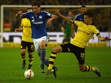 Dortmund's midfielder Julian Weigl and Schalke's midfielder Leon Goretzka vie for the ball during the German first division football Bundesliga match Borussia Dortmund vs FC Schalke 04 on November 8, 2015, 2015 in Dortmund, western Germany.