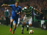 Kieran Tierney of Celtic holds off the challenge from Mattias Mostrom of Molde during the UEFA Europa League Group A match between Celtic FC and Molde FK at Celtic Park on November 5, 2015 in Glasgow, United Kingdom.