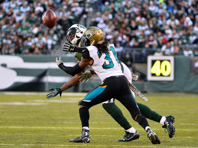 Brandon Marshall #15 of the New York Jets catches a ball under pressure from Davon House #31 of the Jacksonville Jaguars during the third quarter at MetLife Stadium on November 8, 2015