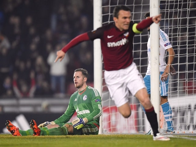 Schalke's goalkeeper Ralf Faehrmann (L) looks on as Prague�s forward David Lafata (R) celebrates his goal during the UEFA Europa League football match AC Sparta Praha vs FC Schalke 04 in Prague, on November 5, 2015.