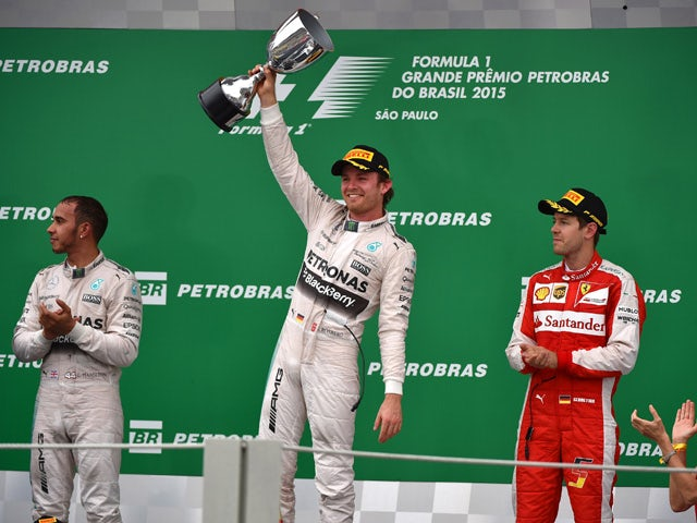 Mercedes' Formula One German driver Nico Rosberg (C) celebrates after winning the Brazilian Grand Prix, at the Interlagos racetrack in Sao Paulo, on November 15, 2015