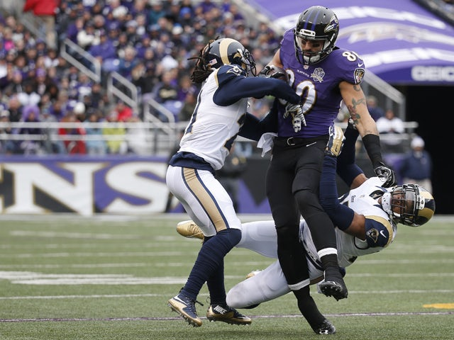 Tight end Crockett Gillmore #80 of the Baltimore Ravens carries the ball against cornerback Janoris Jenkins #21 of the St. Louis Rams and strong safety T.J. McDonald #25 of the St. Louis Rams in the first quarter at M&T Bank Stadium on November 22, 2015