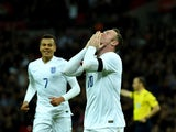 Wayne Rooney of England celebrates scoring his team's second goal during the International Friendly match between England and France at Wembley Stadium on November 17, 2015