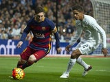 Barcelona's Argentinian forward Lionel Messi (L) vies with Real Madrid's French defender Raphael Varane during the Spanish league 'Clasico' football match Real Madrid CF vs FC Barcelona at the Santiago Bernabeu stadium in Madrid on November 21, 2015.
