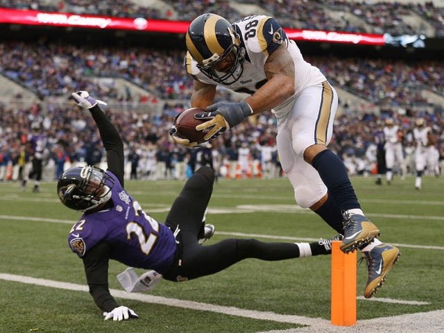 Tight end Lance Kendricks #88 of the St. Louis Rams scores a third quarter touchdown past cornerback Jimmy Smith #22 of the Baltimore Ravens at M&T Bank Stadium on November 22, 2015