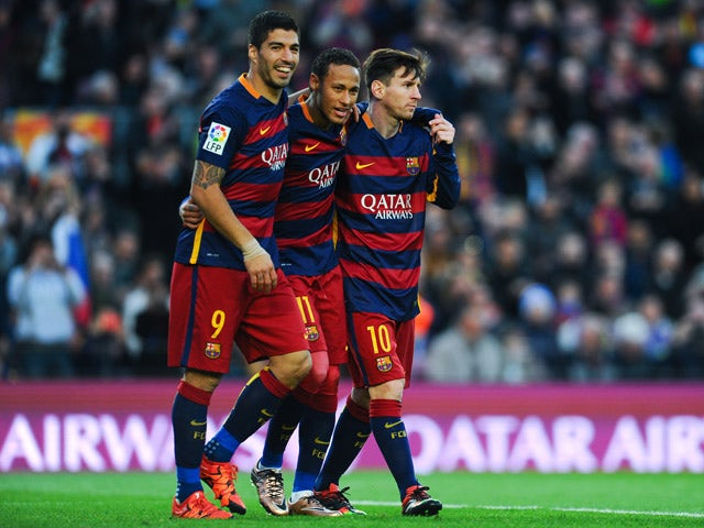 Neymar (C) of FC Barcelona celebrates with his teammates Luis Suarez (L) and Lionel Messi of FC Barcelonaa after scoring his team's third goal of FC Barcelonaduring the La Liga match between FC Barcelona and Real Sociedad de Futbol at Camp Nou on November