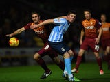 James Hanson of Bradford City battles with Chris Stokes of Coventry City during the Sky Bet League One match between Bradford City and Coventry City at Coral Windows Stadium on November 24, 2015