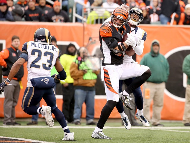 Tyler Eifert #85 of the Cincinnati Bengals makes a catch between Rodney McLeod #23 and Marcus Roberson #47 of the St. Louis Rams at Paul Brown Stadium on November 29, 2015