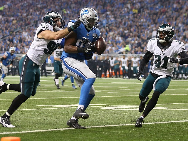 Wide receiver Calvin Johnson #81 of the Detroit Lions drops a first quarter pass while being defended by Byron Maxwell #31 and outside linebacker Connor Barwin #98 of the Philadelphia Eagles on November 26, 2015 at Ford Field in Detroit, Michigan.