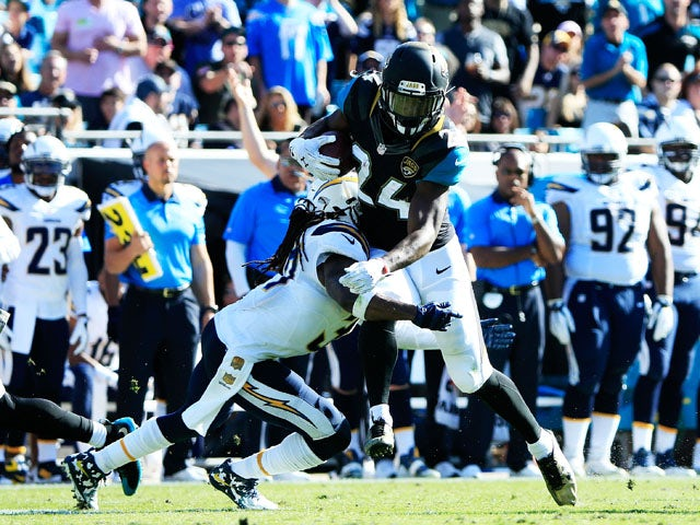 T.J. Yeldon #24 of the Jacksonville Jaguars is tackled by Jahleel Addae #37 of the San Diego Chargers in the second quarter at EverBank Field on November 29, 2015