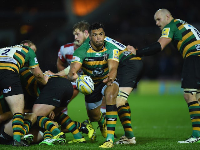 Luther Burrell of Northampton Saints passes the ball during the Aviva Premiership match between Northampton Saints and Gloucester Rugby at Franklin's Gardens on November 27, 2015 in Northampton, England.