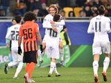Real Madrid's Croatian midfielder Luka Modric celebrates with Real Madrid's Croatian midfielder Mateo Kovacic after scoring during the UEFA Champions League group A football match between Shakhtar Donetsk and Real Madrid in Lviv on November 25, 2015
