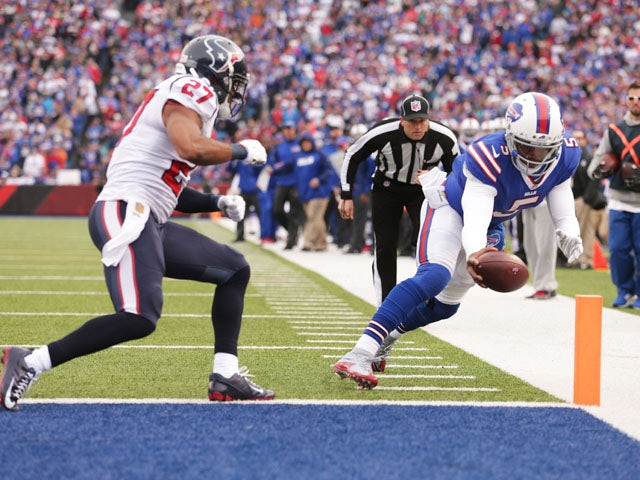 Tyrod Taylor #5 of the Buffalo Bills runs for a touchdown as Quintin Demps #27 of the Houston Texans defends during the first half at Ralph Wilson Stadium on December 6, 2015