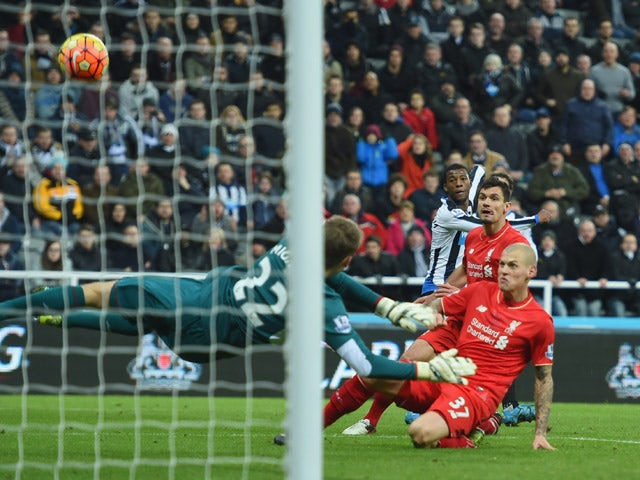 Martin Skrtel of Liverpool (37) deflects a cross from Georginio Wijnaldum of Newcastle United (3R) past goalkeeper Simon Mignolet of Liverpool for an own goal and Newcastle's first during the Barclays Premier League match between Newcastle United and Live