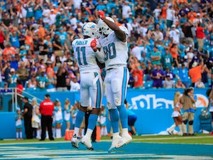 DeVante Parker #11 of the Miami Dolphins celebrates his touchdown in the second quarter with teammate Dion Sims #80 of the Miami Dolphins Dion Sims #80 of the Miami Dolphins at Sun Life Stadium on December 6, 2015