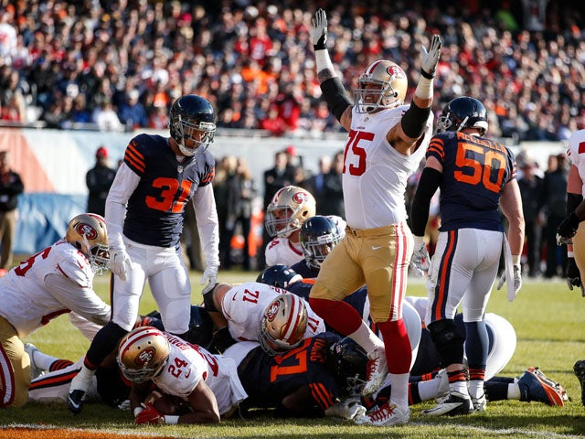 Alex Boone #75 of the San Francisco 49ers celebrates after Shaun Draughn #24 scored a touchdown against the Chicago Bears in the second quarter at Soldier Field on December 6, 2015