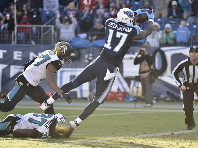 Dorial Green-Beckham #17 of the Tennessee Titans dives to the end zone against the Jacksonville Jaguars during the game at Nissan Stadium on December 6, 2015