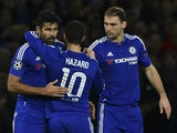 Chelsea's Belgian midfielder Eden Hazard (C) and Chelsea's Serbian defender Branislav Ivanovic (R) celebrate with Chelsea's Brazilian-born Spanish striker Diego Costa (L) after his shot rebounded into the goal for an own goal off Porto's Spanish defender