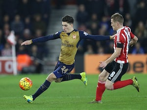 Arsenal defender Hector Bellerin is chased down by Steven Davis of Southampton on December 26, 2015