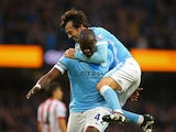 David Silva jumps on Man City teammate Yaya Toure after he scores against Sunderland on December 26, 2015