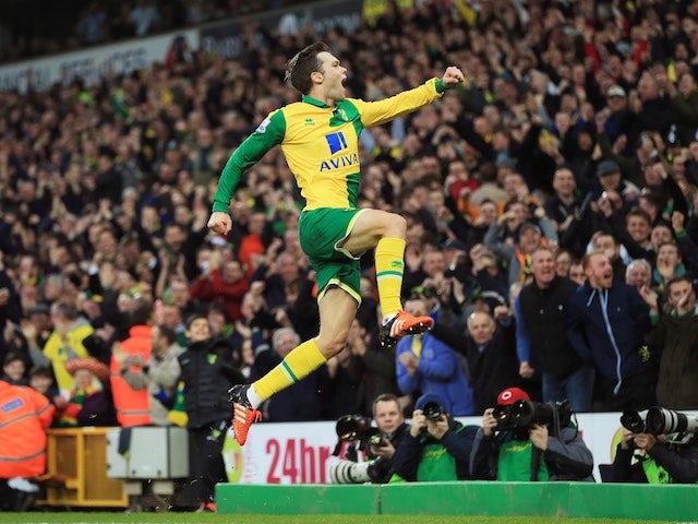 Jonny Howson celebrates scoring Norwich's opener against Aston Villa on December 28, 2015