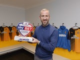 Shaun Derry poses with his Manager of the Month award for December 2015