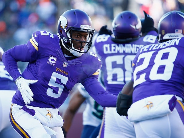 Teddy Bridgewater of the Minnesota Vikings hands the ball off to Adrian Peterson in the first quarter against the Seattle Seahawks on January 10, 2016