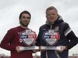 Northampton Town's Ricky Holmes and Chris Wilder pose with their player and manager of the month awards for January 2016