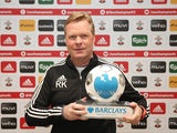 Ronald Koeman poses with his manager of the month award for January 2016
