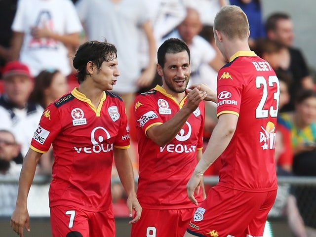 Sergio Cirio of Adelaide United is congratulated by teammates after scoring against Sydney FC at Coopers Stadium on February 5, 2016