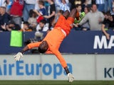 Carlos Kameni celebrates during the La Liga game between Malaga and Real Madrid on February 20, 2016