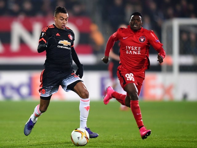 Jesse Lingard of Manchester United and Rilwan Hassan of FC Midtjylland compete for the ball on February 18, 2016