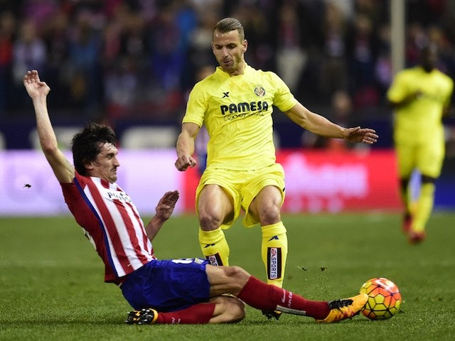 Stefan Savic and Roberto Soldado in action during the La Liga game between Atletico Madrid and Villarreal on February 20, 2016