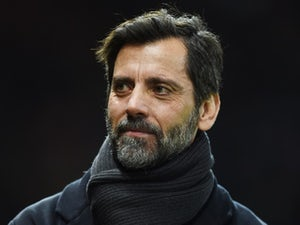Quique Flores looks on during the Premier League match between Manchester United and Watford at Old Trafford on March 2, 2016