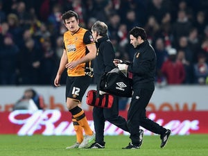 Harry Maguire receives treatment during the FA Cup game between Hull City and Arsenal on March 8, 2016