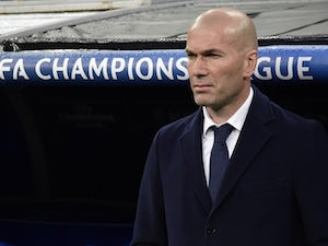 Zinedine Zidane watches on during the Champions League quarter-final between Real Madrid and Wolfsburg on April 12, 2016