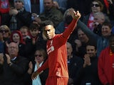 Daniel Sturridge celebrates his opener during the Premier League game between Liverpool and Newcastle United on April 23, 2016