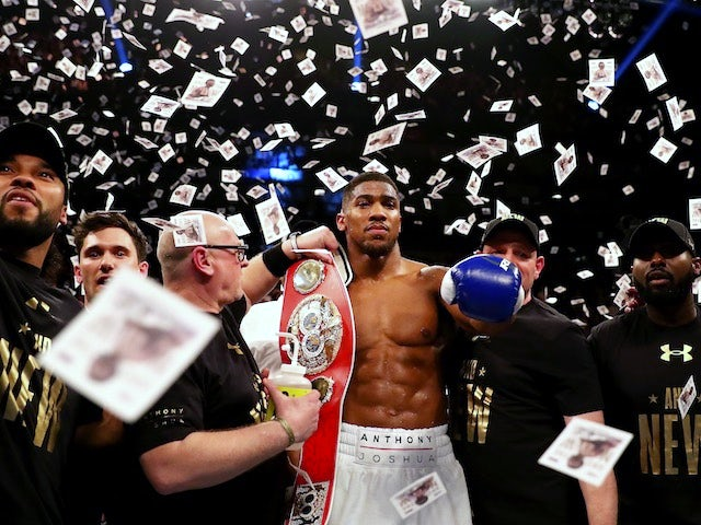 Anthony Joshua celebrates winning the IBF world heavyweight title on April 9, 2016
