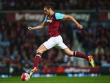 Andy 'The Gazelle' Carroll leaps forward during the Premier League game between West Ham United and Manchester United on May 10, 2016