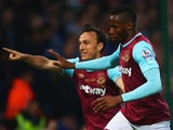 Diafra Sakho celebrates scoring with Mark Noble during the Premier League game between West Ham United and Manchester United on May 10, 2016
