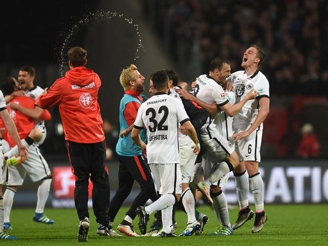 Eintracht Frankfurt's players celebrate after the Bundesliga second-leg relegation football match against Nuremberg on May 23, 2016