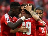 Admir Mehmedi is congratulated after scoring during the Euro 2016 Group A game between Romania and Switzerland on June 15, 2016