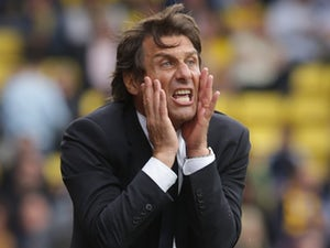 Chelsea manager Antonio Conte strikes a pose on August 20, 2016